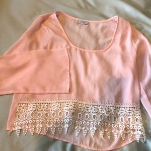 Pink crop with bell sleeves and lace detail